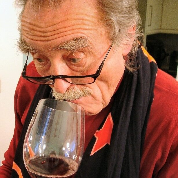 Man in Smoking Jacket Tasting Wine